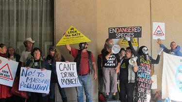 Anti-coal seam gas protestors rally outside the annual CSG summit in Brisbane today.