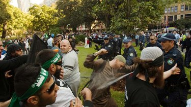 Running battles ... protesters, furious at a US film denigrating the prophet Muhammad clash with police on the streets of Sydney yesterday.