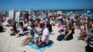 An estimated 4000 people gathered at Cottesloe Beach on January 4 to protest the shark cull.