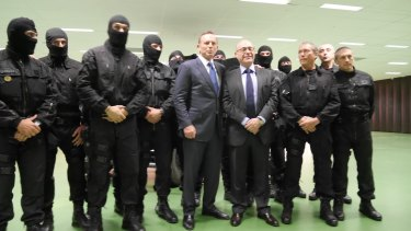 Tony Abbott poses with members of the French counter-terrorism unit.