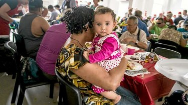 Sarah, eight months old, with her mother Helen at the St Kilda Mission on Christmas Day.