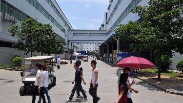 Workers walk between buildings at a giant Foxconn plant at Shenzen, in southern China.