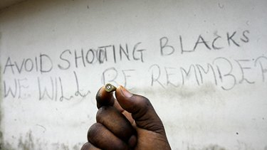 An immigrant shows a bullet found near the Rosarno camp.