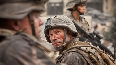 Aaron Eckhart is shaken, battled and... well shaken and battled a bit more in <i>Battle: Los Angeles</i>.