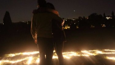 A photo of the candles used in park for proposal.