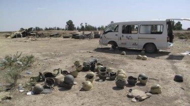 Abandoned Iraqi military helmets outside Kirkuk.