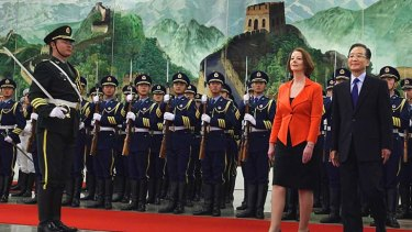 Dialogue... the Prime Minister, Julia Gillard, and the Chinese Premier, Wen Jiabao, view an honour guard during a welcoming ceremony in Beijing yesterday.