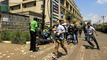 Unrest: customers run following a shoot-out between armed men and the police at the Westgate shopping mall in Nairobi.