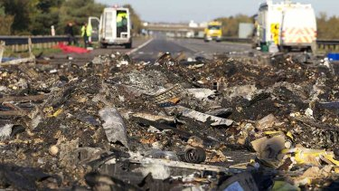 Debris on the motorway in the wake of the pile-up, where some cars were literally burnt to the ground.
