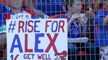 Fans show their support for stricken Newcastle player Alex McKinnon.