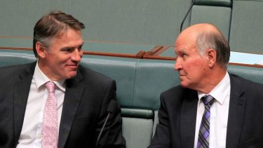 Independent MPs Rob Oakeshott, left, and Tony Windsor are angry at a deal between Labor and the Coalition on political funding.