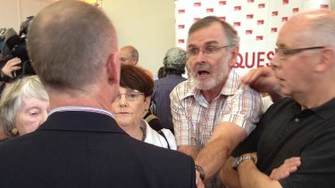 A man angrily confronts LNP leader Campbell Newman after fiery community forum in Ashgrove.