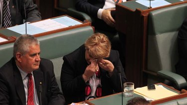 Natasha Griggs wipes her eyes as she listens to Michael Keenan speak.