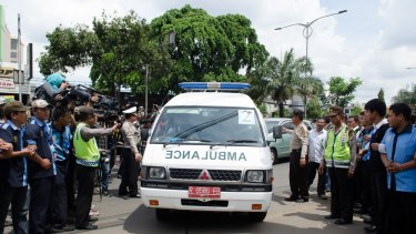 Ambulances carrying the bodies of Myuran Sukumaran and Andrew Chan arrive at the Abadi Funeral Homes in Daan Mogot, West Jakarta.