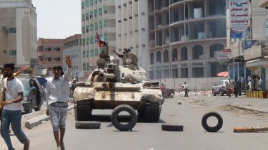Militiamen loyal to Yemen's exiled president Abed Rabbo Mansour Hadi take positions at a street in Aden on April 2.