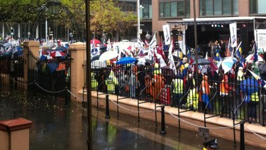 Storming the gates ... thousands of workers rally outside NSW Parliament to protest against expected cuts to the state's WorkCover scheme.