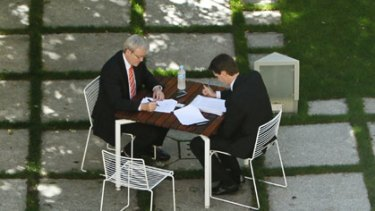 Balancing the books... after Tuesday's national health reform negotiations with state leaders, Kevin Rudd talks with his chief economic adviser, Andrew Charlton, in a quiet courtyard inside Parliament House yesterday.