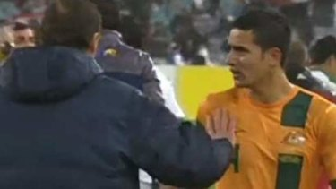 Not happy: Tim Cahill reacts after being substituted.