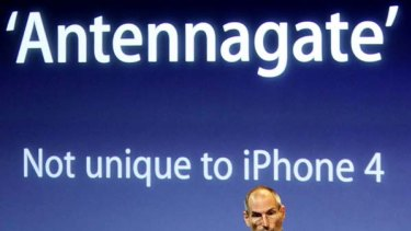 Apple CEO Steve Jobs appears on stage during a news conference at Apple headquarters in Cupertino, California, to address the issue of the iPhone 4's reception issues.
