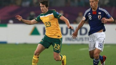 Robbie Kruse is chased by Keisuke Honda of Japan during the AFC Asian Cup Final in 2011.