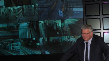 "Transport Minister Troy Buswell gets a first-hand look at the ""Big Brother"" facilities and 32 screens of Transperth's new central monitoring room."