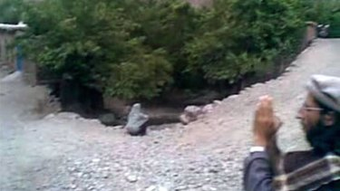 Executed ... this frame grab shows Najiba  sitting at the edge of a ditch shortly before being executed after being accused of adultery with a Taliban commander.