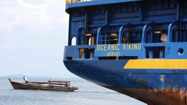 The Australian customs vessel the Oceanic Viking, carrying Sri Lankan asylum seekers, and a traditional Indonesian boat off Bintan Island, Indonesia in October 2009.