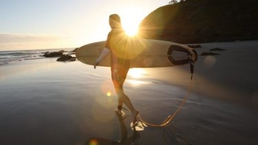 A surfer hits Watego's Beach at Byron Bay.