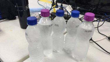 Media had labels on bottles that were not from Olympic sponsors removed.