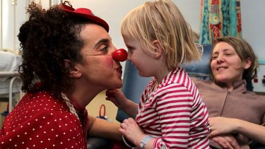 The best medicine ... clown doctor Avital Dvory entertains Freyja Marchand.
