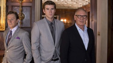 Paranoia stars (from left) Gary Oldman, Liam Hemsworth and Harrison Ford.
