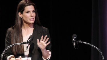 Actress Sandra Bullock accepts her Razzie award for worst actress in a feature film.
