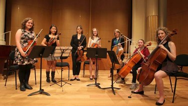On song: Sydney Symphony Orchestra violinist, Kirsten Williams (standing) with students at The Independent Theatre, North Sydney. Eleanor Betts (a mentor) is third from right on cello.
