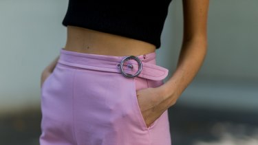 Metallic rings and a cropped tee tone down the prettiness of pink and balance the look.