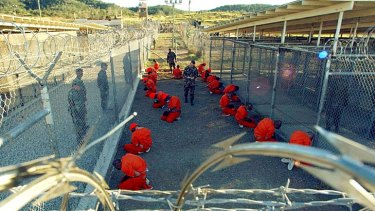 Detainees arrive at Guantanamo Bay on January 11, 2002.