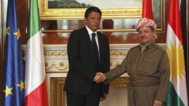 Iraqi Kurdish regional President Masoud Barzani shakes hands with Italy's Prime Minister Matteo Renzi in Erbil.