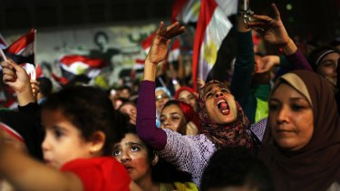 People dance and cheer in Cairo's Tahrir Square after  Egyptian President Mohammed Mursi was ousted last week.