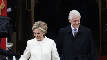 Hillary Clinton (with President Bill Clinton) helped cement white as the colour of unity and feminism.