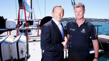 Tony Abbott, posing yesterday for pictures with yacht owner Anthony Bell, was again too busy to answer questions from reporters.