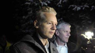 WikiLeaks founder Julian Assange speaks to the media outside Ellingham Hall as WikiLeaks spokesman Kristinn Hrafnsson looks on.