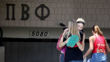 Students console each other outside the Pi Beta Phi Sorority near San Diego State University after news that a student had died.