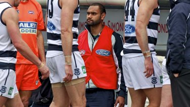 Travis Varcoe on the bench after being subbed out of the game in round 22.