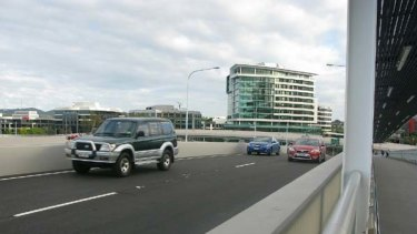 Road test ... motorists take their first drive over the Go Between Bridge.
