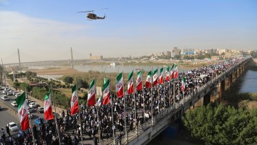 Striking back: pro-government demonstrators rally in the restive south-western Iranian city of Ahvaz on Wednesday.