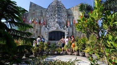 Standing together ... Australians visiting the Bali memorial.
