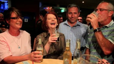 The Sydney Morning Herald and The Age have backed Prime Minister Julia Gillard, seen here enjoying a drink in Raymond Terrace last night.