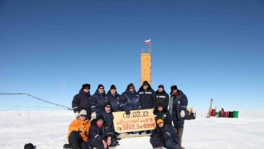 'Like flying to the moon' ... Russian researchers pose for a picture after reaching the subglacial lake Vostok.