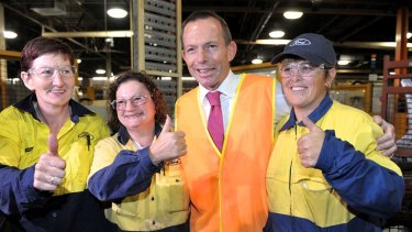 Thumbs up ... Tony Abbott with workers at the Ford factory in Geelong.