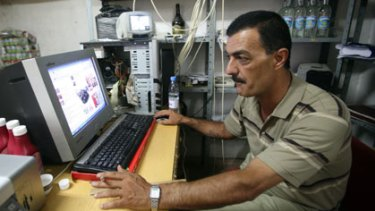 Christian Palestinian Ayman Abu Aitta watches extracts from the movie <i>Bruno</i> , over which he intends to take the creator Sacha Baron Cohen to court.
