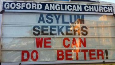 Father Rod Bower's signs on asylum seekers.